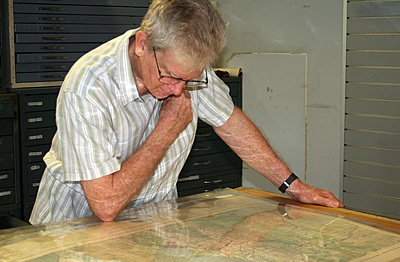 Alan Broughton at work on the maps