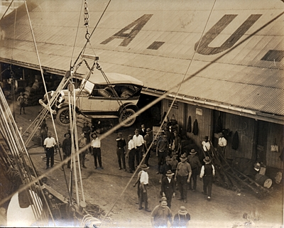 P07309 Undated image of early motor vehicle being lowered onto Cairns Wharf