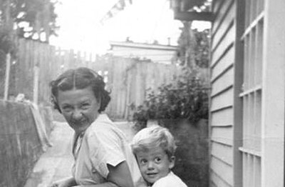 P15864 Mavis Tinney and her grandson Ashley Wilson have fun on a child's tricycle about 1960
