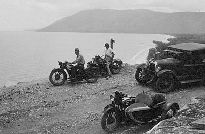 P15896 Cars and motorbikes on an outing at Rex Lookout Cook Highway, 1930s. Photographer S A Doblo