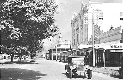 P16528. Spence Street with car on street near Bolands and Central Hotel, 1920s
